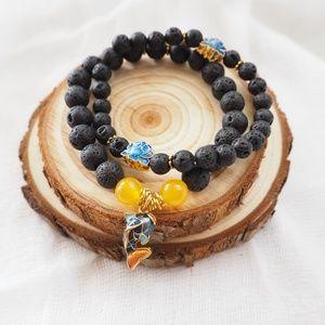 NWOT Asian style hand made bead elastic bracelets